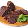 Basturma, dried fillet of beef meat, cut into thin slices. — Stock Photo #57773581