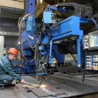 Постер, плакат: Automated submerged arc welding process industrial enterprise