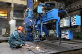 Automated submerged arc welding process, industrial enterprise — Stock Photo