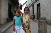 Two little black Arab girl standing on a narrow street. — Stock Photo