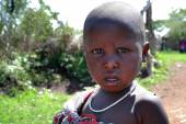 One black african child with a dirty face, closeup portrait. — Stock Photo