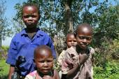 Group of African black children Maasai in rags. — Stock Photo