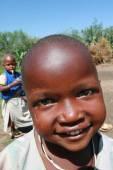 Black African Maasai tribe smiling child, close-up. — Stock Photo
