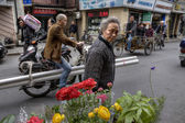 Lively street Asian city, townspeople  ride on motorcycles and b — Stock Photo