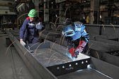 Process gas welding at plant for production of bridge structures — Stock Photo