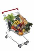 Filled foodstuffs shopping cart isolated on white background, no body — Stock Photo
