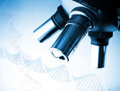 Microscope and DNA — Stock Photo