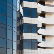 Fragment of office building from glass and concrete. — Stock Photo #55570885