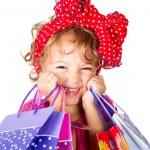 Little girl doing shopping — Stock Photo #52598771