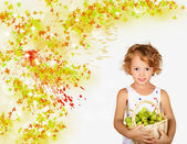Little girl with basket of white grapes — Stock Photo