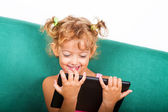 5 year old girl with tablet — Stock Photo