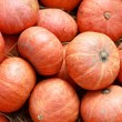 Small decorative pumpkins at a farmers market — Stock Photo #62156229