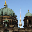 The Berlin television tower between the main dome and lantern dome of the Berlin Cathedral — Stock Photo #61289213