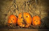 Halloween pumpkins with board — Stock Photo