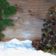 Christmas tree made of cones with fir branches — Stock Photo #56948721