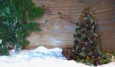 Christmas tree made of cones with fir branches — Stock Photo