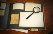 Vintage documents with magnifying glass  — Foto Stock