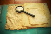 Vintage documents with magnifying glass  — Stockfoto