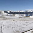Panoramic view of snowy plateau of Castelluccio of Norcia, in Um — Stock Photo #61573999