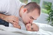 Father giving a kiss to his son — Stock Photo