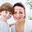 Smiling happy adorable family with colors on them face - funny m — Stock Photo #69462339