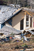 Tornado damaged wood frame house — Stock Photo