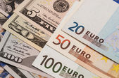 Photo of the american and euro banknotes — Stock Photo