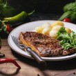 Grilled steak with potatoes — Stock Photo #55597551