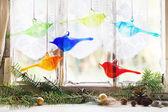 Interior window with glass birds and christmas tree — Stock Photo