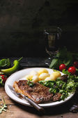 Grilled steak with potatoes — Stock Photo