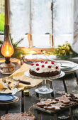 Table setting with chocolate cake — Stock Photo