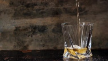 Pouring whiskey in glass — Stock Video