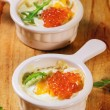 Baked eggs with red caviar — Stock Photo #58505783
