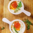 Baked eggs with red caviar — Stock Photo #58505793