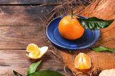 Tangerine on blue plate — Stock Photo