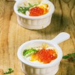 Baked eggs with red caviar — Stock Photo #59023309