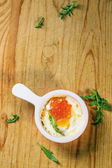Baked egg with red caviar — Stock Photo