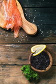 Salted salmon and black caviar — Stock Photo