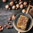 Honeycomb and nuts — Stock Photo #59534509