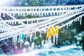 Icicles on clothesline with snow — Stock Photo