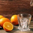 Pouring whiskey from bottle to glass over gray background with orange — Stock Video #60471111