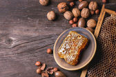 Honeycomb and nuts — Stock Photo