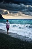 Girl walking by the sea  — Stock Photo