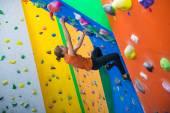Indoor climbing girl — Stock Photo