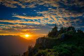Summit cross at sunset — Stock Photo