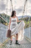 Escaping bride on the bridge — Stock Photo