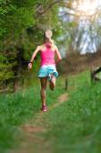 Blonde girl athlete running in a trail into the woods — Foto de Stock