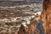Ruins of Masada with the desert of depression of the Dead Sea in — Stock Photo