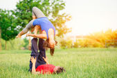 Couple practicing acroyoga in the park — Stock Photo
