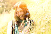 Hippie girl in the meadow in a photograph with vintage artifacts — Stock Photo